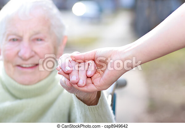 Senior Lady and Young Woman Holding Hands - csp8949642