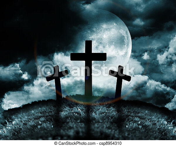 Silhouette of three crosses on a hill - csp8954310