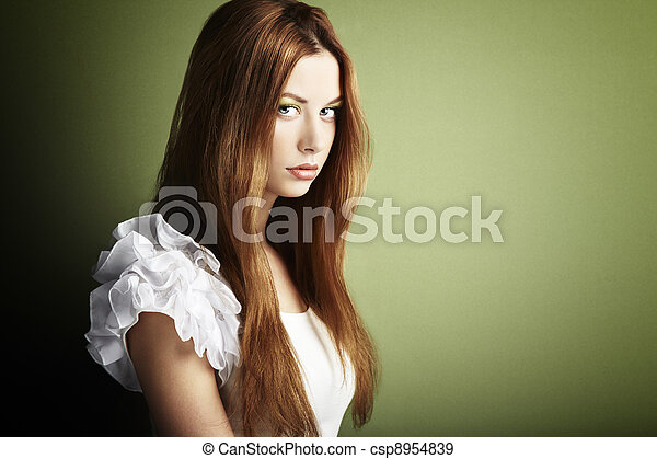 Fashion photo of a young woman with red hair - csp8954839
