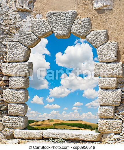 Green Grass Field Landscape with fantastic clouds through the window - csp8956519