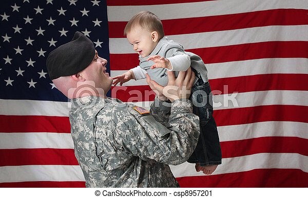 American Soldier holds his infant son - csp8957201