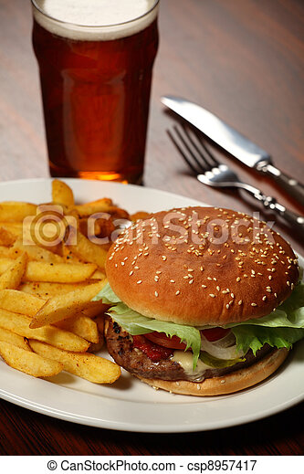 Burger and fries at a Pub - csp8957417