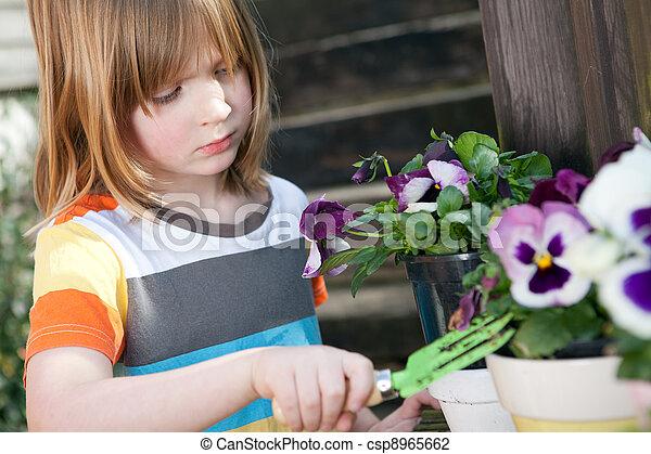 Gardening child garden flowers planting plant - csp8965662