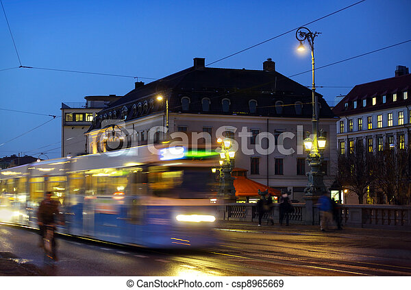 Gothenburg at night. Some trams and people in motion - csp8965669