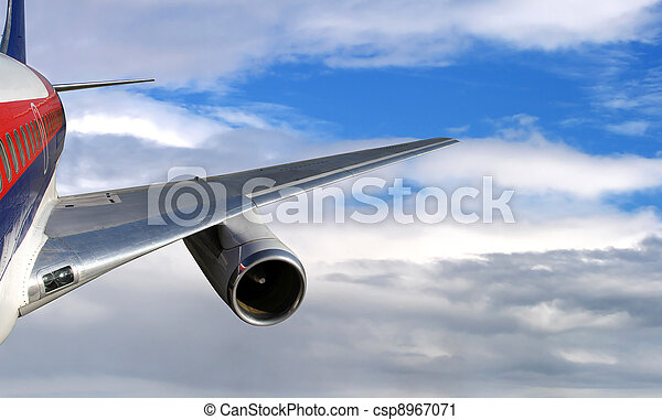 Airliner flying in high cloudy sky - csp8967071