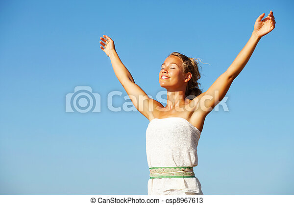 Young woman with arms raised - csp8967613