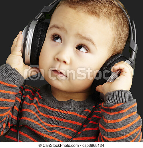 portrait of a handsome kid listening to music looking up over bl - csp8968124