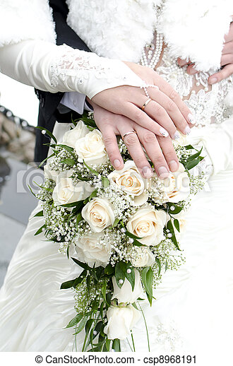 Bridal bouquet of flowers with hands of newlyweds - csp8968191