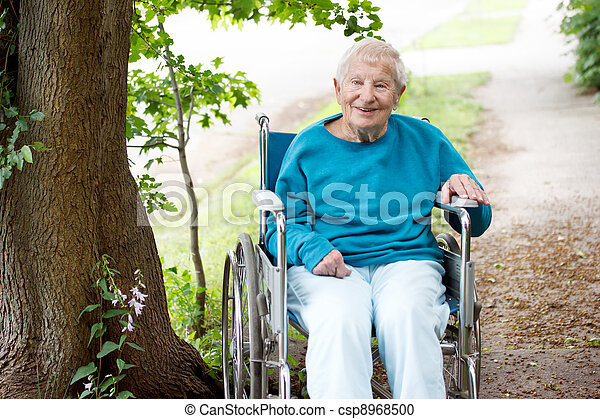 Senior Lady in Wheelchair Smiling - csp8968500