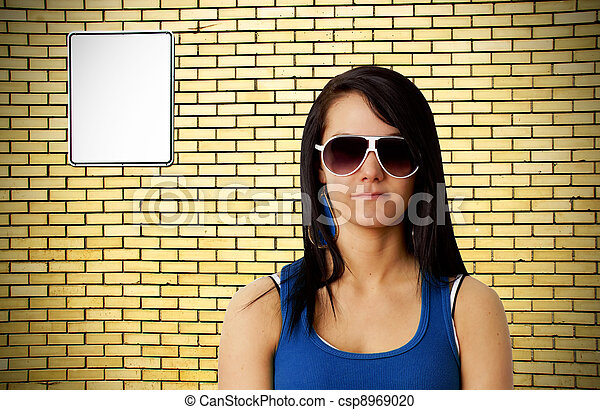 Tough girl and brick wall - csp8969020