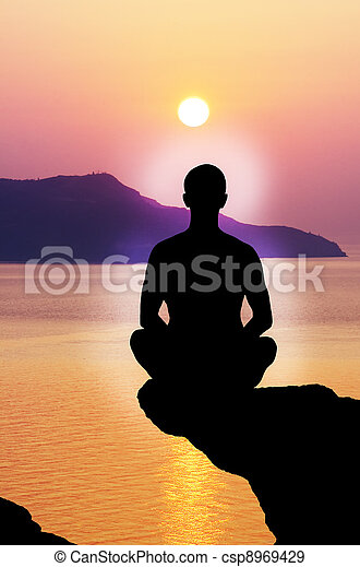 Silhouette of the meditating person - csp8969429