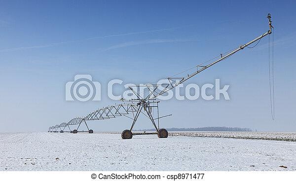 Irrigation pivot in winter - csp8971477