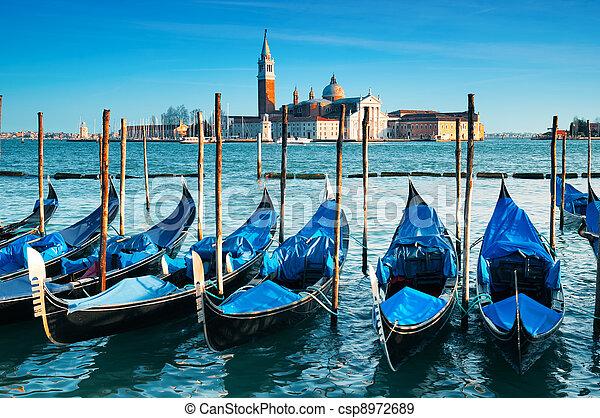 San Giorgio Maggiore church and gondolas in Venice - csp8972689