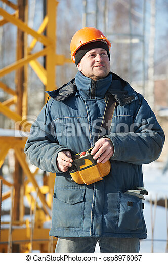 Builder with tower crane remote control equipment - csp8976067