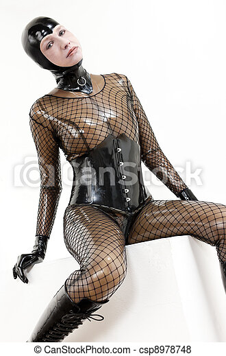 sitting woman wearing latex clothes - csp8978748