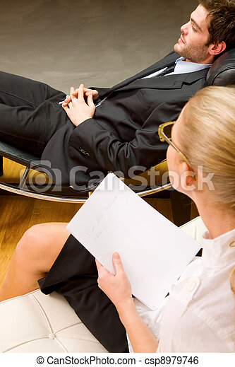 psychiatrist examining a male patient - csp8979746