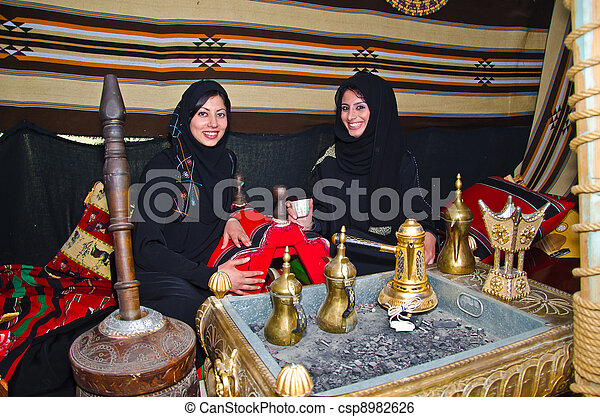 Arab Women sitting in a traditional tent - csp8982626