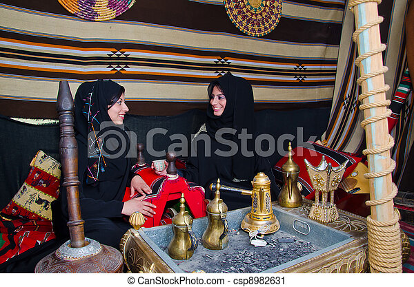 Arab Women sitting in a traditional tent - csp8982631
