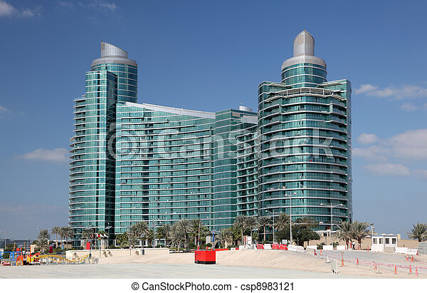 Modern highrise building at Dubai Festival City, United Arab Emirates - csp8983121