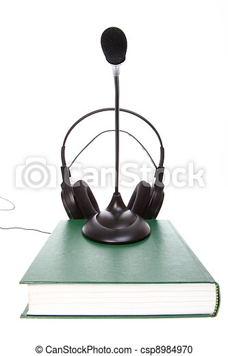 headset with a microphone, hardcover books stack isolated - csp8984970