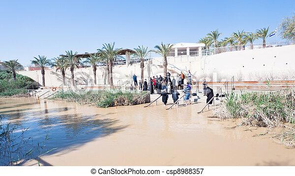 baptized people in Jesus Christ baptism site in Jordan River - csp8988357