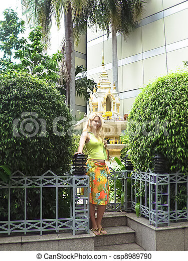 A pregnant woman near the altar in the park. Bangkok, Thailand - csp8989790