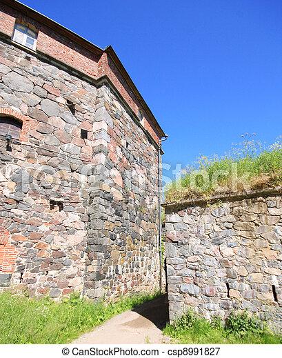 Stone Wall of Suomenlinna Sveaborg Fortress in Helsinki, Finland - csp8991827
