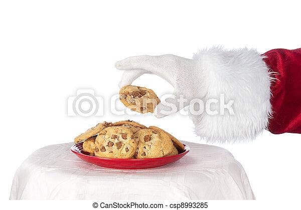 Santa grabbing cookie - csp8993285