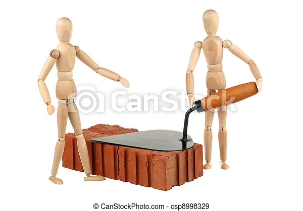 Two dummy, red brick and trowel - csp8998329