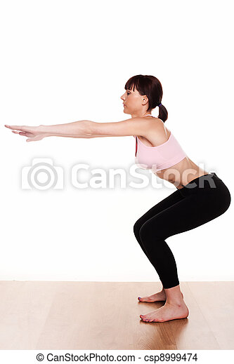 woman doing a squat exercise - csp8999474