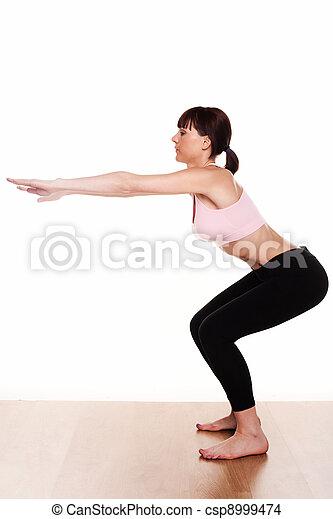 woman doing a squat exercise - csp8999474