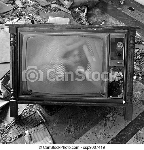 ghostly figure on vintage tv set - csp9007419