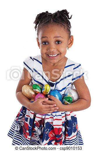 Little african american girl holding chocolate easter eggs - csp9010153