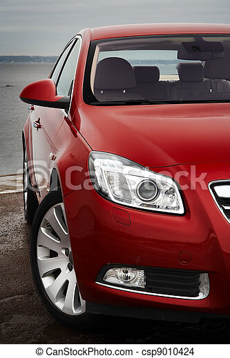 Cherry red car front detail - csp9010424