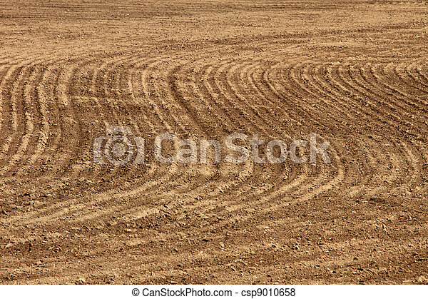 Agriculture background - plowed field - csp9010658