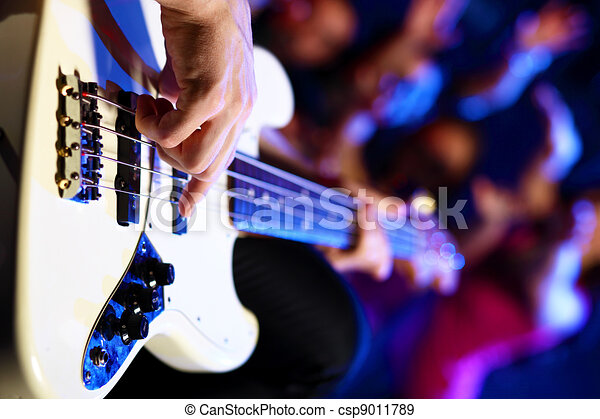 Young guitar player performing in night club - csp9011789