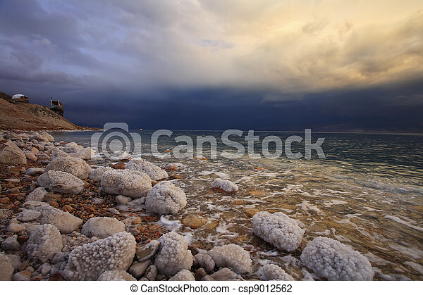 Coast of the Dead Sea in Israel in a spring thunder-storm. The coastal stones covered by salty adjournment - csp9012562