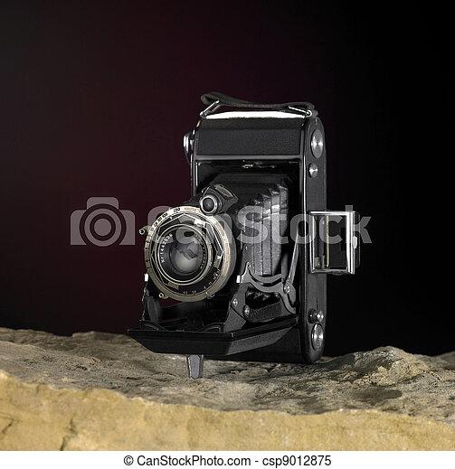 nostalgic camera on stone surface - csp9012875