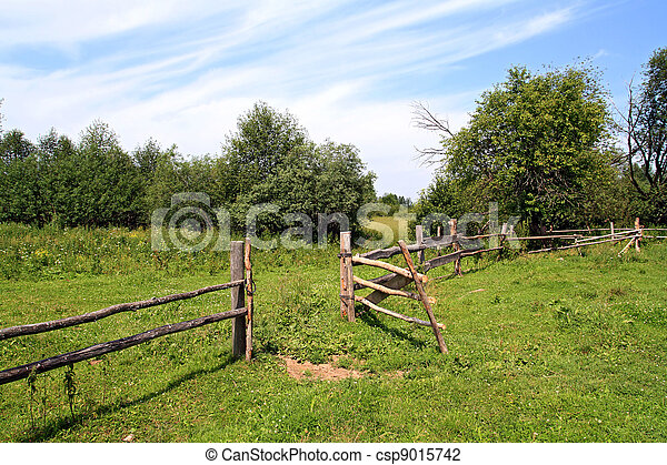 wooden fence on green pasture - csp9015742