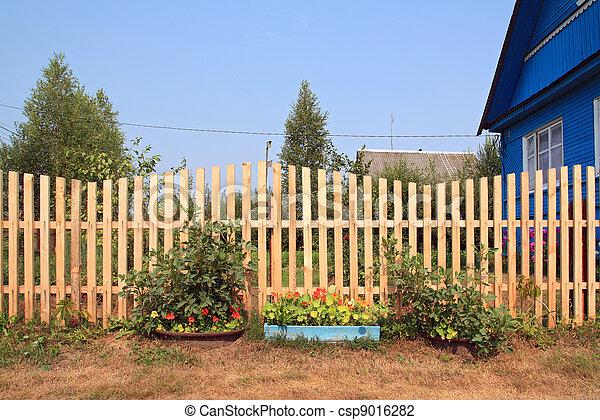 autumn flowerses near wooden fence - csp9016282