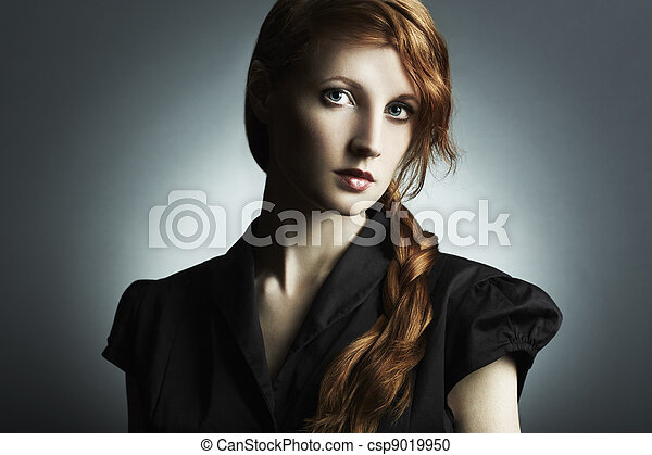 Fashion photo of a beautiful young red-haired woman - csp9019950