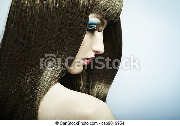 Fashion portrait of a young beautiful dark-haired woman - csp9019954