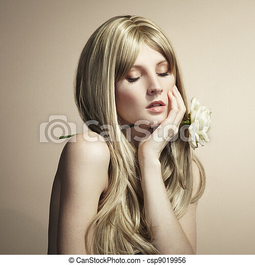 Fashion photo of a young woman with blond hair - csp9019956