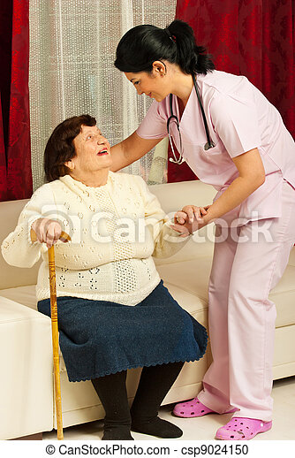 Nurse caring elderly woman at home - csp9024150