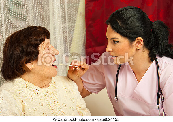 Doctor examine elderly for sore throat - csp9024155