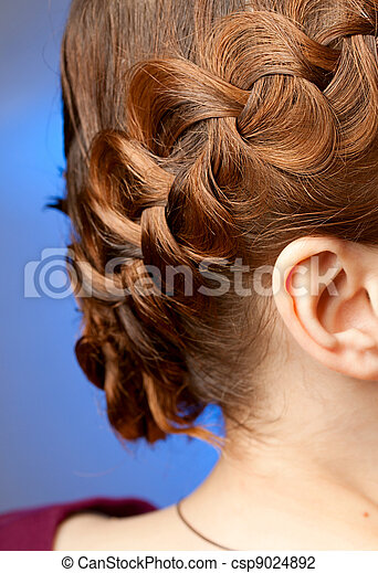 Modern hairdo with plaits sideview - csp9024892