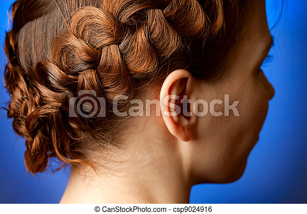Modern hairdo with plaits sideview - csp9024916