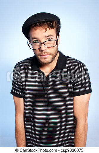 Young man modern nerd wide angle portrait blue background - csp9030075