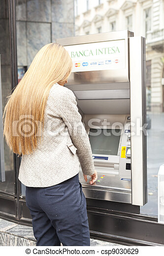 Woman using Bank ATM machine - csp9030629
