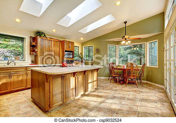 stock photo of large country kitchen with skylights. - large green